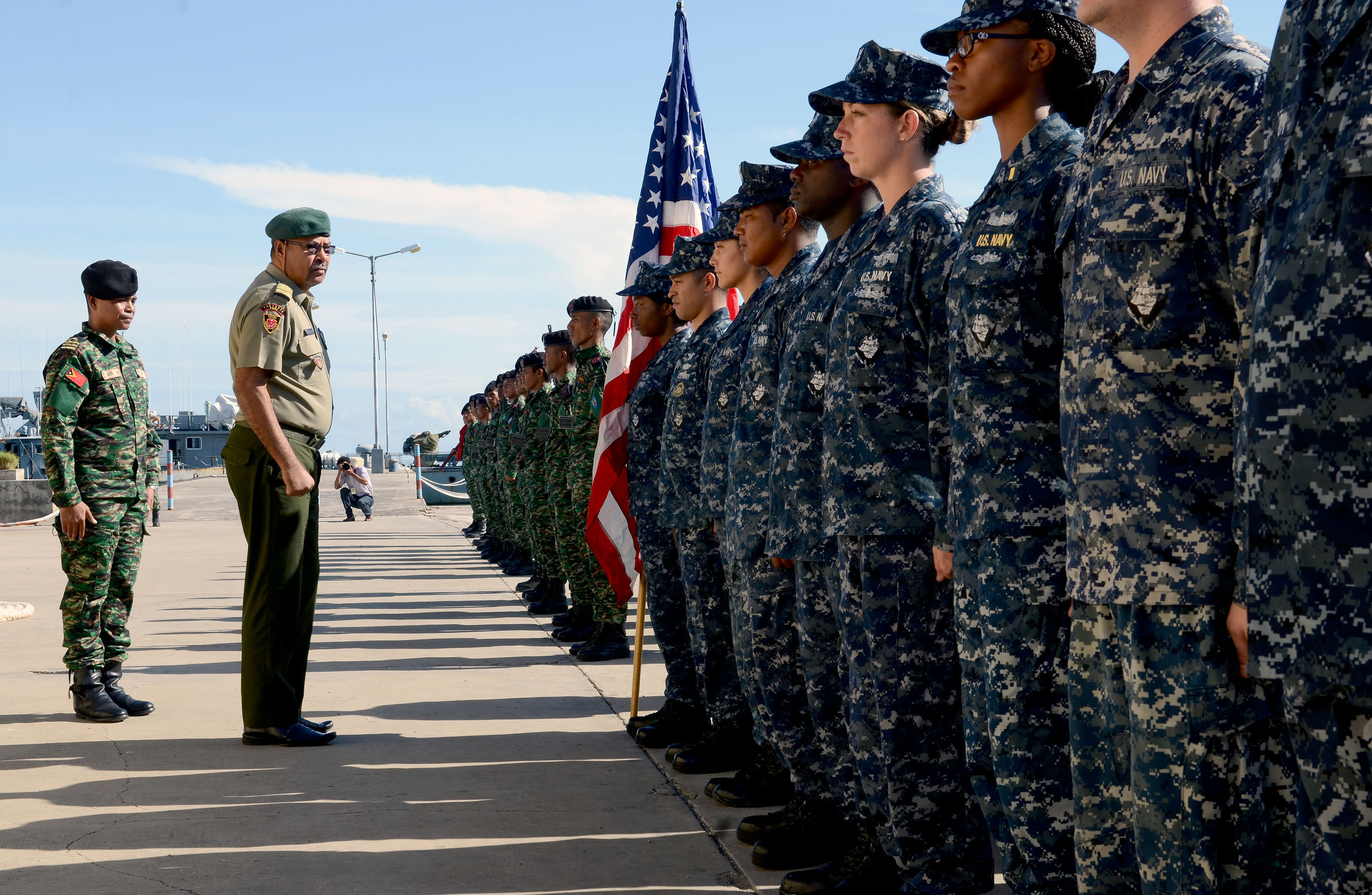 Chief of Staff of the Timor-Leste Defense Force Col. Falur Rate Laek, second from left, inspects U.S. Sailors assigned to the guided missile destroyer USS Kidd (DDG 100) and Timor-Leste Defense Force service members Feb. 24, 2014, during the opening ceremony of Cooperation Afloat Readiness and Training (CARAT) 2014 in Port Hera, East Timor. CARAT is a series of bilateral exercises held annually in Southeast Asia to strengthen relationships and enhance force readiness. (DoD photo by Mass Communication Specialist 1st Class Jay C. Pugh, U.S. Navy/Released)