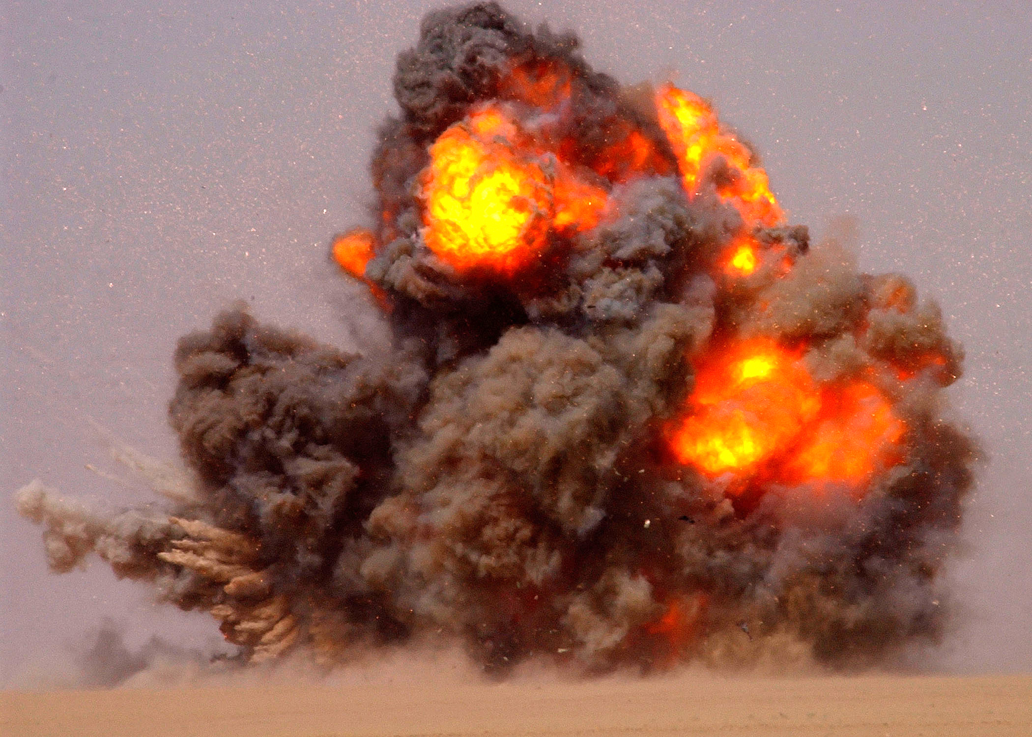 """020712-N-5471P-010 Udairi Range, Kuwait (Jul. 12, 2002) -- Explosive Ordnance Disposal (EOD) technicians explode or """"Cook off"""" old ammunition and ordnance that is no longer usable.  EOD technicians use C-4 Plastic explosive charges to completely destroy the weapons.  EOD teams from the U.S. Army, Navy, Air Force, and coalition forces conduct training exercises to improve joint capabilities between the services.  U.S. Navy photo by PhotographerÕs Mate 2nd Class Aaron Peterson.  (RELEASED)"""